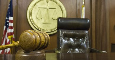 Hammer and gavel near judges chair in court