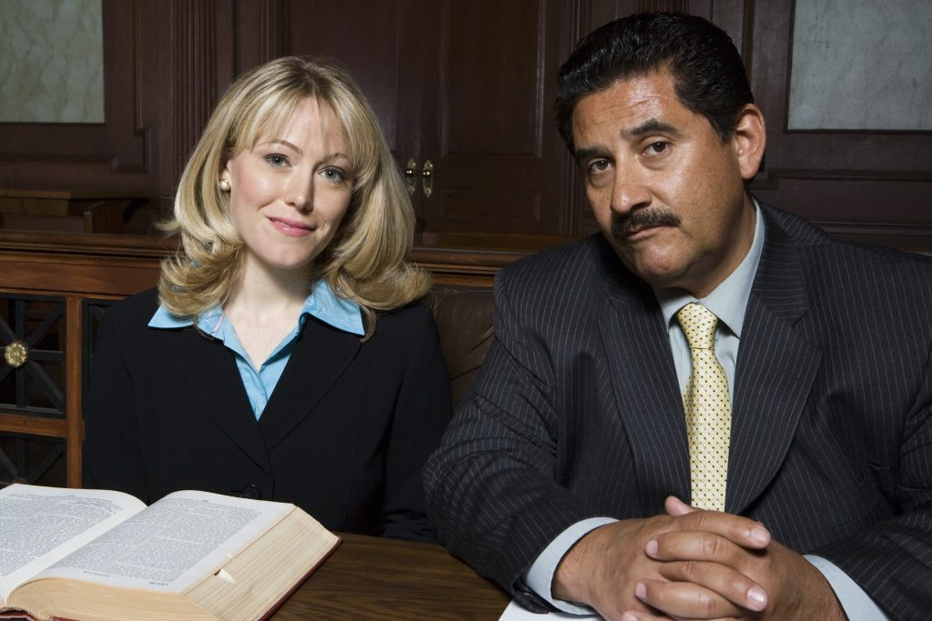 Man and woman sitting in court, portrait